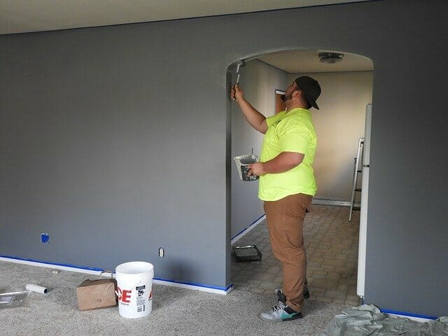 A man repainting a wall